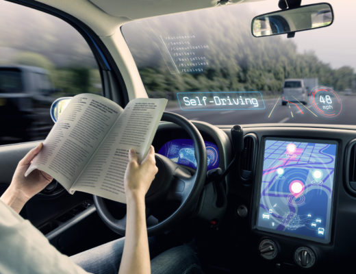 Women reading in a self driving car - TripJohn